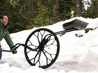 Sno Wovel Wheeled Snow Shovel